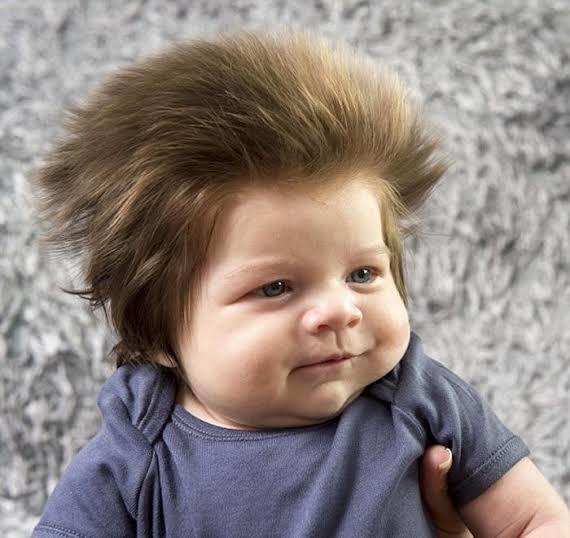 Yine gür saçlı farklı bir bebek